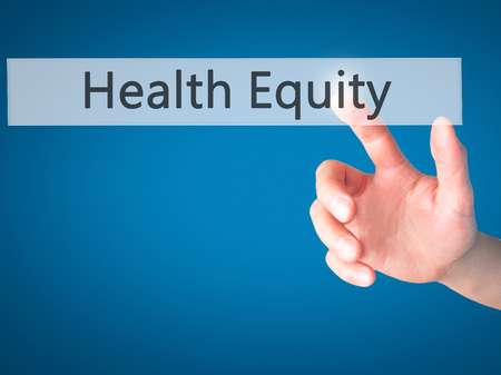 health equity: Health Equity - Hand pressing a button on blurred background concept . Business, technology, internet concept. Stock Photo
