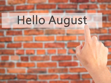 hi back: Hello August - Hand pressing a button on blurred background concept . Business, technology, internet concept. Stock Photo Stock Photo