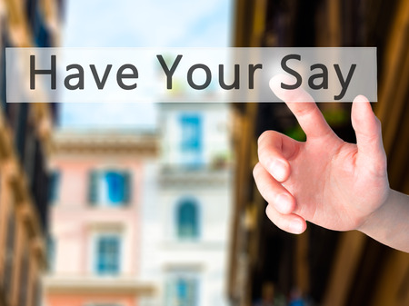 suggestions: Have Your Say - Hand pressing a button on blurred background concept . Business, technology, internet concept. Stock Photo