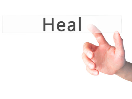 resonate: Heal - Hand pressing a button on blurred background concept . Business, technology, internet concept. Stock Photo Stock Photo