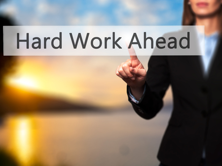 hard work ahead: Hard Work Ahead - Businesswoman hand pressing button on touch screen interface. Business, technology, internet concept. Stock Photo Stock Photo