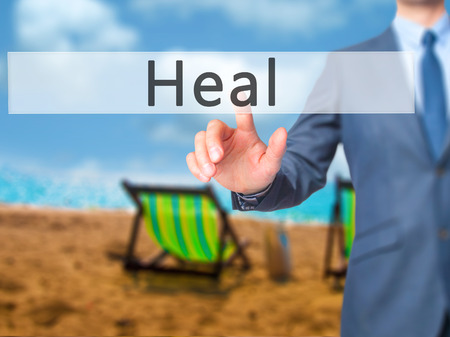 soulful: Heal - Businessman hand pressing button on touch screen interface. Business, technology, internet concept. Stock Photo Stock Photo