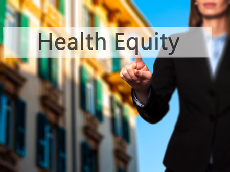 health equity: Health Equity - Businesswoman hand pressing button on touch screen interface. Business, technology, internet concept. Stock Photo Stock Photo