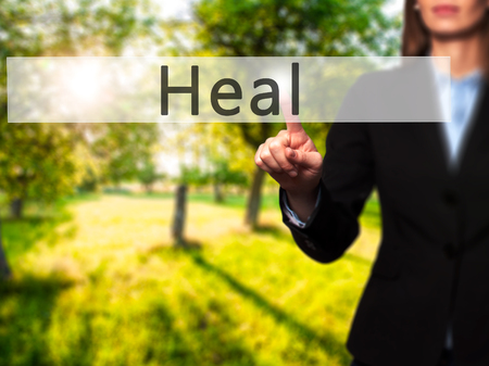 resonate: Heal - Businesswoman hand pressing button on touch screen interface. Business, technology, internet concept. Stock Photo