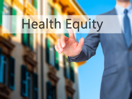 health equity: Health Equity - Businessman hand pressing button on touch screen interface. Business, technology, internet concept. Stock Photo