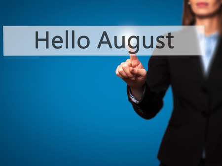 hi back: Hello August - Businesswoman hand pressing button on touch screen interface. Business, technology, internet concept. Stock Photo Stock Photo