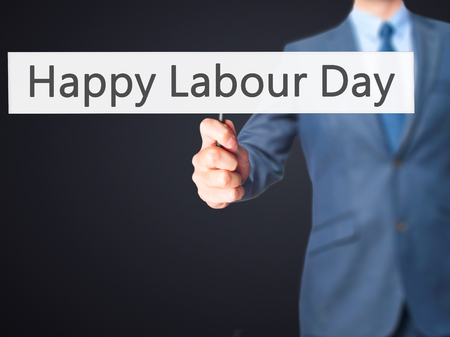 Happy Labour Day - Businessman hand holding sign. Business, technology, internet concept. Stock Photo