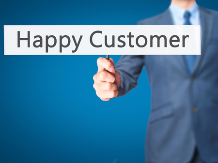 cause marketing: Happy Customer - Businessman hand holding sign. Business, technology, internet concept. Stock Photo