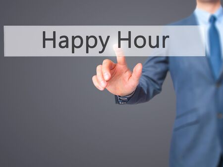 happyhour: Happy Hour - Businessman hand pressing button on touch screen interface. Business, technology, internet concept. Stock Photo