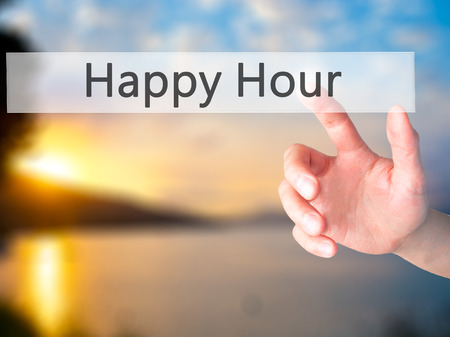 happyhour: Happy Hour - Hand pressing a button on blurred background concept . Business, technology, internet concept. Stock Photo Stock Photo