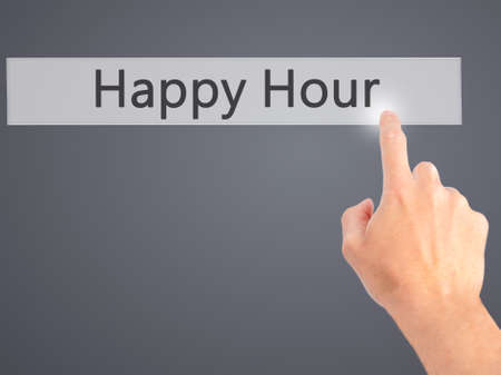 hour hand: Happy Hour - Hand pressing a button on blurred background concept . Business, technology, internet concept. Stock Photo Stock Photo