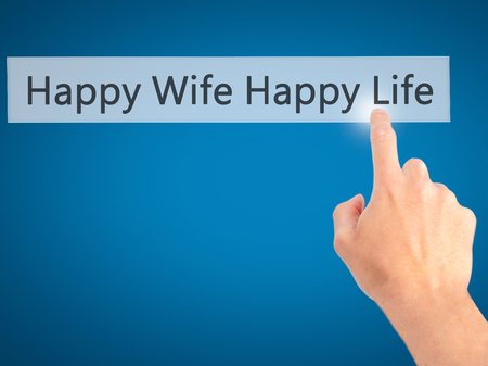 wedlock: Happy Wife Happy Life - Hand pressing a button on blurred background concept . Business, technology, internet concept. Stock Photo Stock Photo