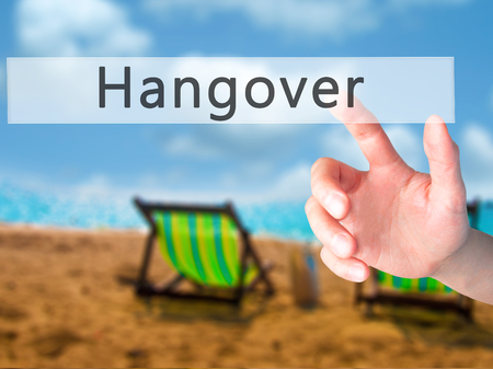 hangover: Hangover - Hand pressing a button on blurred background concept . Business, technology, internet concept. Stock Photo