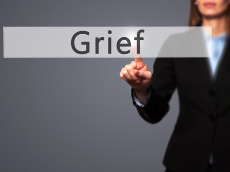 hassle: Grief - Businesswoman hand pressing button on touch screen interface. Business, technology, internet concept. Stock Photo