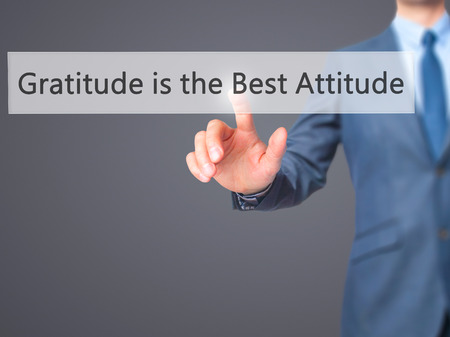 positiveness: Gratitude is the Best Attitude - Businessman hand pressing button on touch screen interface. Business, technology, internet concept. Stock Photo