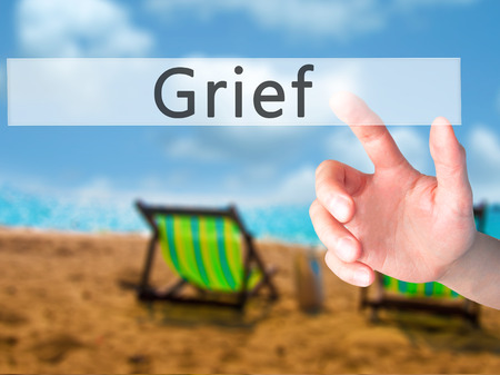 dejection: Grief - Hand pressing a button on blurred background concept . Business, technology, internet concept. Stock Photo Stock Photo