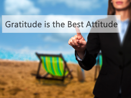 positiveness: Gratitude is the Best Attitude - Businesswoman hand pressing button on touch screen interface. Business, technology, internet concept. Stock Photo