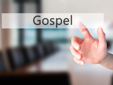 dogma: Gospel - Hand pressing a button on blurred background concept . Business, technology, internet concept. Stock Photo