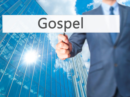 gospel: Gospel - Businessman hand holding sign. Business, technology, internet concept. Stock Photo