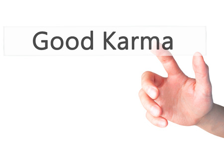 Good Karma Hand Pressing A Button On Blurred Background Concept
