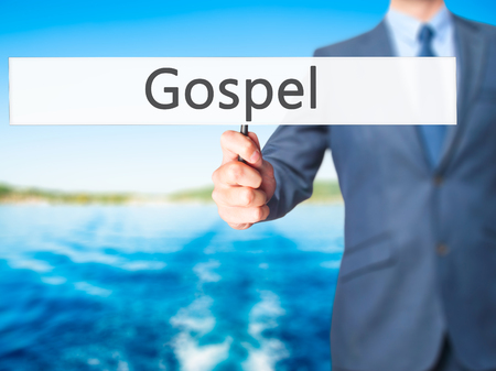 working ethic: Gospel - Businessman hand holding sign. Business, technology, internet concept. Stock Photo
