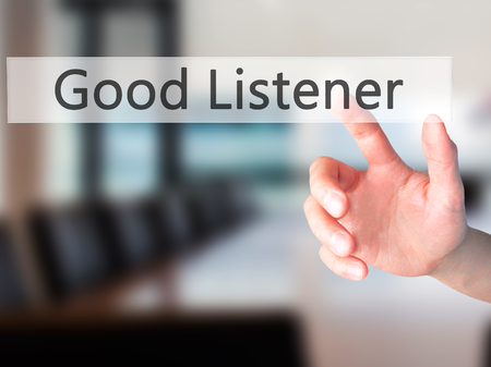 listener: Good Listener - Hand pressing a button on blurred background concept . Business, technology, internet concept. Stock Photo