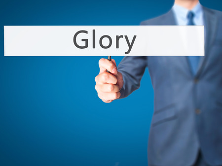 keys to heaven: Glory - Businessman hand holding sign. Business, technology, internet concept. Stock Photo