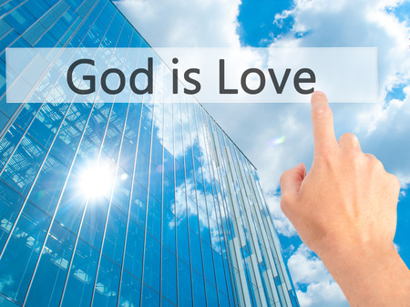 god button: God is Love - Hand pressing a button on blurred background concept . Business, technology, internet concept. Stock Photo
