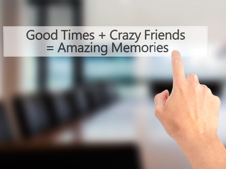 Good Times  Crazy Friends  Amazing Memories - Hand pressing a button on blurred background concept . Business, technology, internet concept. Stock Photo