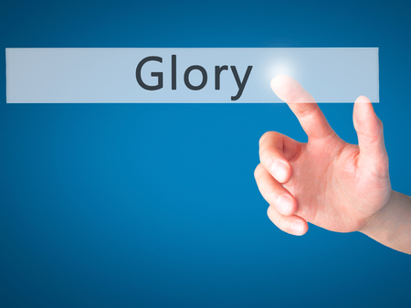 keys to heaven: Glory - Hand pressing a button on blurred background concept . Business, technology, internet concept. Stock Photo