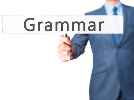 noun: Grammar - Businessman hand holding sign. Business, technology, internet concept. Stock Photo