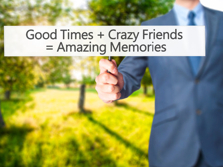 good times: Good Times  Crazy Friends  Amazing Memories - Businessman hand holding sign. Business, technology, internet concept. Stock Photo