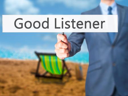 listener: Good Listener - Businessman hand holding sign. Business, technology, internet concept. Stock Photo