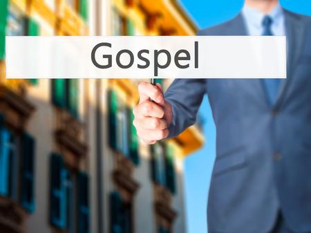 dogma: Gospel - Businessman hand holding sign. Business, technology, internet concept. Stock Photo