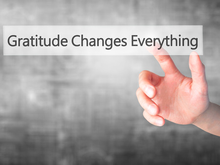 Gratitude Changes Everything - Hand pressing a button on blurred background concept . Business, technology, internet concept. Stock Photo Reklamní fotografie