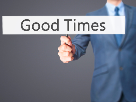 good times: Good Times - Businessman hand holding sign. Business, technology, internet concept. Stock Photo