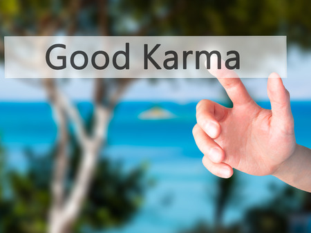 karma: Good Karma - Hand pressing a button on blurred background concept . Business, technology, internet concept. Stock Photo Stock Photo