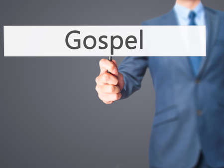 credo: Gospel - Businessman hand holding sign. Business, technology, internet concept. Stock Photo