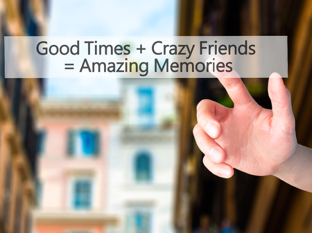 good times: Good Times  Crazy Friends  Amazing Memories - Hand pressing a button on blurred background concept . Business, technology, internet concept. Stock Photo