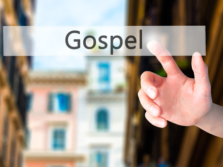 working ethic: Gospel - Hand pressing a button on blurred background concept . Business, technology, internet concept. Stock Photo