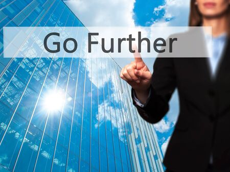 further: Go Further - Businesswoman hand pressing button on touch screen interface. Business, technology, internet concept. Stock Photo