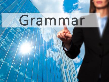 noun: Grammar - Businesswoman hand pressing button on touch screen interface. Business, technology, internet concept. Stock Photo