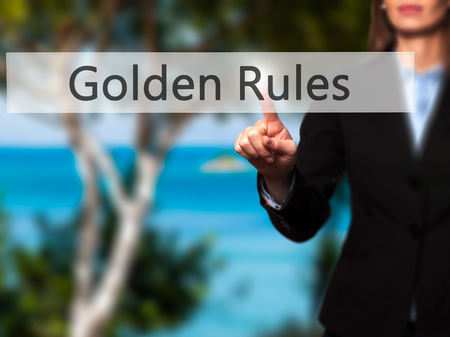 golden rule: Golden Rules - Businesswoman hand pressing button on touch screen interface. Business, technology, internet concept. Stock Photo