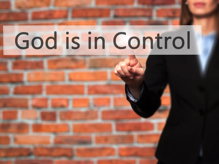 sanctification: God is in Control - Businesswoman hand pressing button on touch screen interface. Business, technology, internet concept. Stock Photo Stock Photo