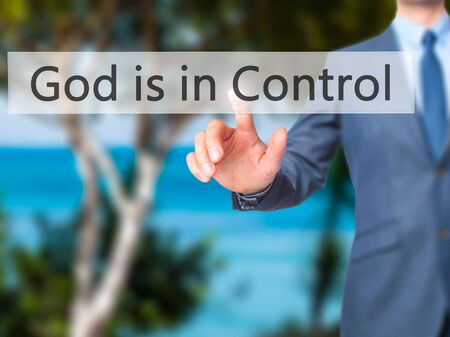 confessing: God is in Control - Businessman hand pressing button on touch screen interface. Business, technology, internet concept. Stock Photo
