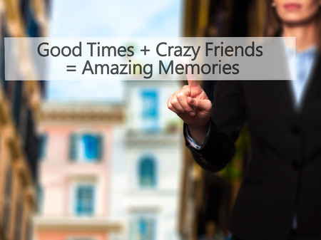 positiveness: Good Times  Crazy Friends  Amazing Memories - Businesswoman hand pressing button on touch screen interface. Business, technology, internet concept. Stock Photo