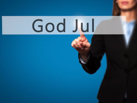 god button: God Jul (Merry Christmas in Swedish) - Businesswoman hand pressing button on touch screen interface. Business, technology, internet concept. Stock Photo Stock Photo