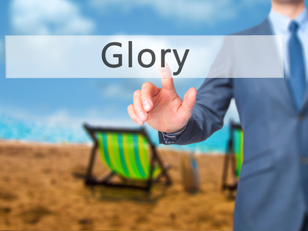 keys to heaven: Glory - Businessman hand pressing button on touch screen interface. Business, technology, internet concept. Stock Photo