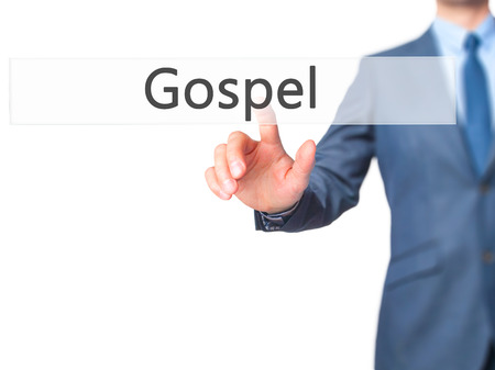 working ethic: Gospel - Businessman hand pressing button on touch screen interface. Business, technology, internet concept. Stock Photo