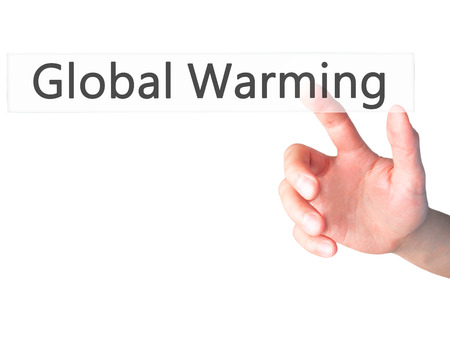 ecological problem: Global Warming - Hand pressing a button on blurred background concept . Business, technology, internet concept. Stock Photo
